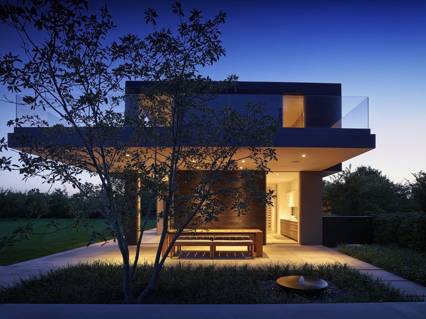 Sagaponack Modern House Outdoor Dining at Dusk