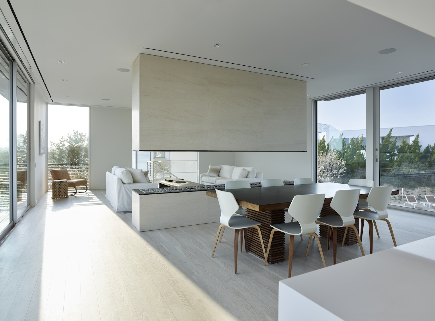 Amagansett, NY modern house dining room and fireplace