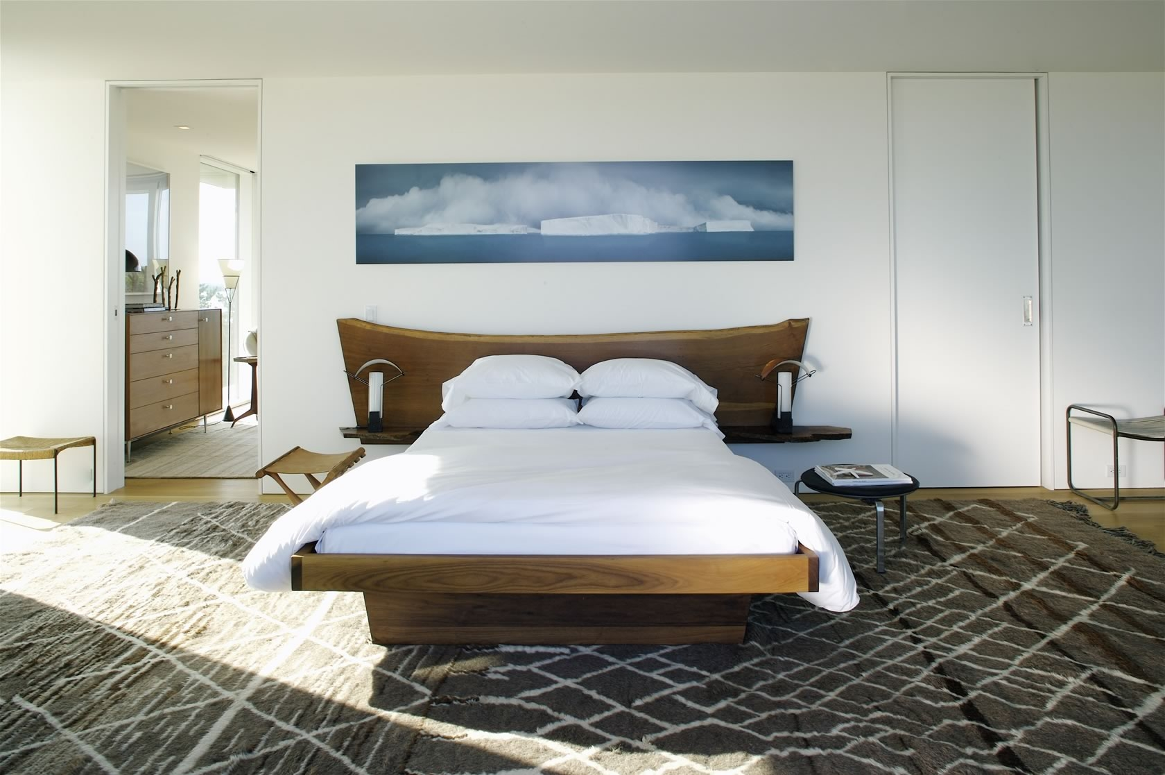 Bridgehampton, NY Modern Oceanfront House master bedroom with vintage George Nakashima headboard